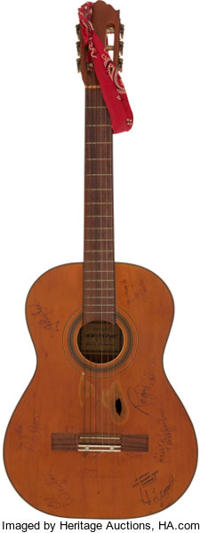Willie Nelson's guitar, signed by Waylon Jennings and Johnny
